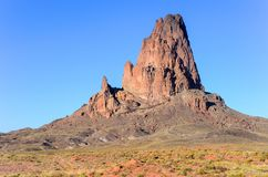 Steep, rugged, rocky peak in a desert setting royalty free stock photography