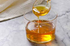 Agave syrup pouring on a glass. Stock Image