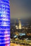 Agbar torn och Sagrada Familia domkyrka, Barcelona, Spanien Royaltyfri Foto