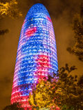 Agbar Tower at Night. BARCELONA, SPAIN - JULY 24, 2015: Night view of the Agbar tower constructed in 2005. Since then it's a Barcelona landmark Royalty Free Stock Photo