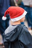 AGDE, FRANCE - SEPTEMBER 9, 2017: A boy in a New Year hat at an exhibition of retro cars Volkswagen. Close-up. Vertical. AGDE, FRANCE - SEPTEMBER 9, 2017: A boy Royalty Free Stock Photography