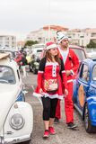 AGDE, FRANCE - SEPTEMBER 9, 2017: People in New Year`s costumes at the exhibition of retro cars Volkswagen Cap d`Agde. Stock Photos
