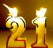 Age 21 Candles. 'Age 21' candles being blown out Stock Images