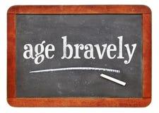 Age bravely - reminder on blackboard stock photography