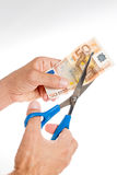 Age of cheap cuts. Simulation of cutting a 50 euro bottomed Isolated Royalty Free Stock Photos
