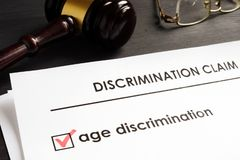 Age discrimination claim in the court stock photography