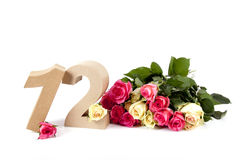 Age in figures on a bed of roses Stock Photo