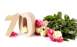 Age in figures on a bed of roses Stock Image