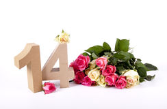 Age in figures on a bed of roses Stock Photography