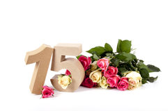 Age in figures on a bed of roses Stock Images
