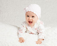 The age when happiness is pure and absolute. Studio high key portrait of a happy infant girl Stock Image
