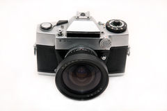 Age-old camera. Age-old fotokamera of the last century on a whitу background Stock Images