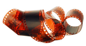 Age-old film. An age-old film is involute chaotically on a white background Royalty Free Stock Photography