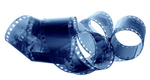Age-old film. An age-old film is involute chaotically on a white background Royalty Free Stock Photos