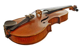 Age-old  violin. Age-old musical instrument is a violin, isolated on a white background Royalty Free Stock Photo