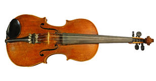 Age-old  violin. Age-old musical instrument is a violin, isolated on a white background Stock Photo