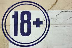 18+ Age Restriction Sign Symbol. On The Old Concrete Wall Background Royalty Free Stock Image