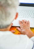 Age spotted hands on the laptop Royalty Free Stock Photos