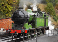 The Age of Steam. Locomotive on an English Railway with steam coming from the stack Stock Image