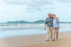 Free Age, Travel, Tourism And People Concept - Happy Senior Couple Holding Hands And Walking On Summer Beach Royalty Free Stock Images - 156778239