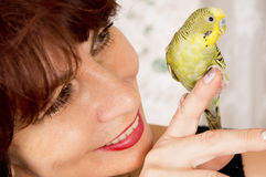 In age woman with a parrot Royalty Free Stock Photo