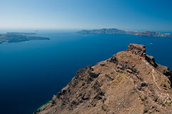 Agean sea. View from Santorini island with hill and walking track in the foreground Royalty Free Stock Image