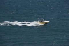 Speedboat travels at speed Stock Photos