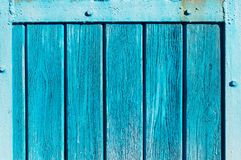 Aqua colored wooden gate with iron stripes stock images