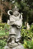 Aged asian god statue Stock Photography