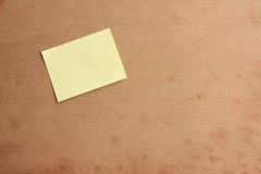 Aged background with post it note Stock Image