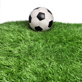Aged ball on grass field Royalty Free Stock Photo