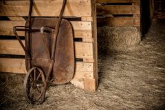 Aged Barrow in the Barn Royalty Free Stock Photography
