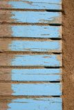Aged beach blue wooden floor on sand Stock Images