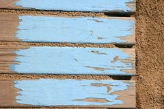 Aged beach blue wooden floor on sand Stock Photos