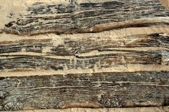 Aged beach wood texture with sand weathered Royalty Free Stock Photography