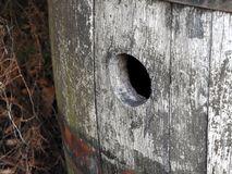 Aged beer barrel. Close up of the bung hole on an old barrel Stock Photo