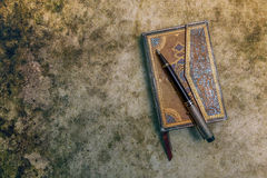 Aged book with pen, retro style Stock Image