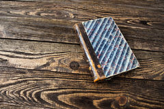 Aged book on wooden table Royalty Free Stock Images