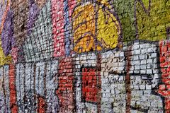Aged brick wall with graffity royalty free stock photos