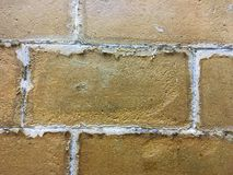 Aged brick wall. The wall has been used for a long time and it is full of scratches Royalty Free Stock Image