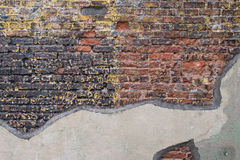 Aged Brick Wall with Worn Black Paint Royalty Free Stock Images