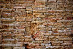 Aged bricks brown background wall Royalty Free Stock Images