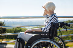 Aged bright woman trying seeing something stock images