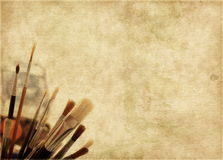Aged brown background with painters brushes Royalty Free Stock Photography