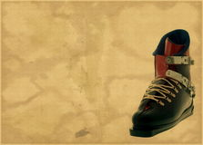 Aged brown background with ski boot Stock Images