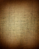 Aged brown fabric as vintage background Royalty Free Stock Images