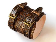 Aged brown leather bracelet filled with embossed skulls - botton view royalty free stock images