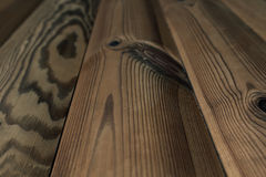 The aged brown planks. The wood texture. The background. Royalty Free Stock Photo