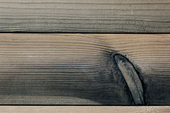 The aged brown planks. The wood texture. The background. Stock Photo