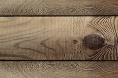 The aged brown planks. The wood texture. The background. Stock Image